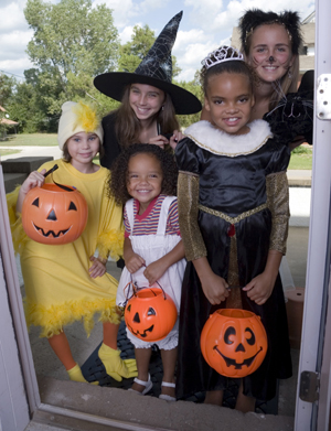 Kids in costume trick or treating