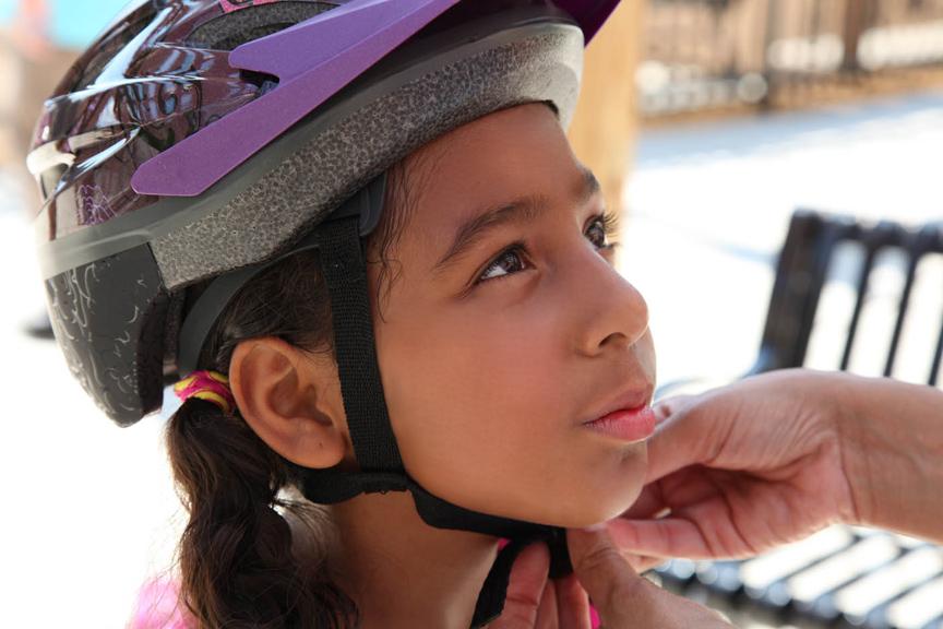 Girl in bicycle helmet