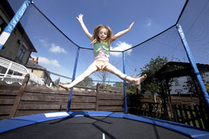 Girl bouncing on trampoline