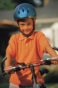 boy on a bicycle wearing a helmet
