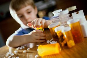boy opening medicine bottles
