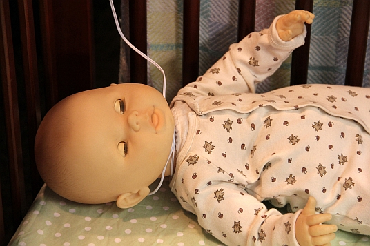 Baby strangles in a video monitor cord