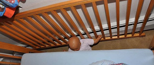 crib with loose side pushed against wall