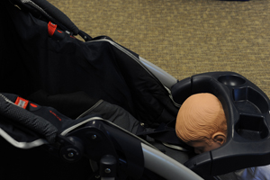Baby trapped between the tray and seat of a stroller